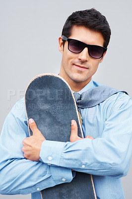 Buy stock photo Businessman with sunglasses holding skateboard