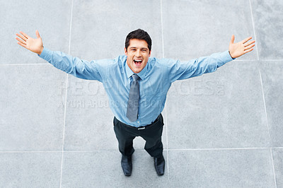 Buy stock photo Happy businessman standing outside with arms outstretched