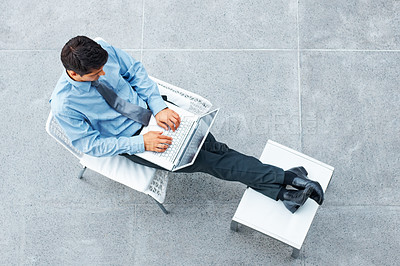 Buy stock photo Top view of executive sitting in chair, working on laptop
