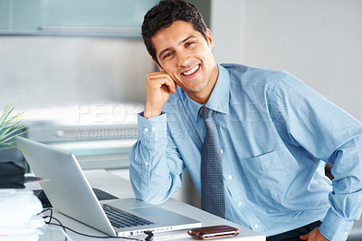 Buy stock photo Smiling business man resting face on hand while sitting at desk