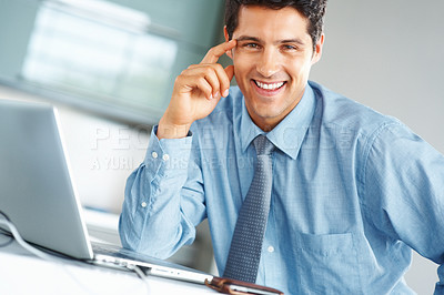 Buy stock photo Friendly executive sitting in front of laptop