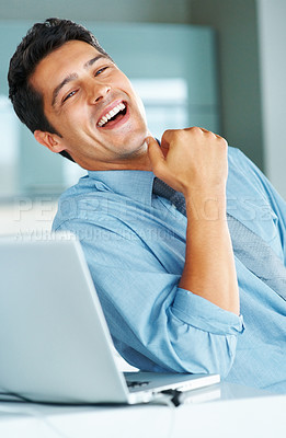 Buy stock photo Cheerful executive leaning back and laughing near laptop