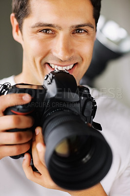 Buy stock photo View of photographer smiling as he prepares to take photo