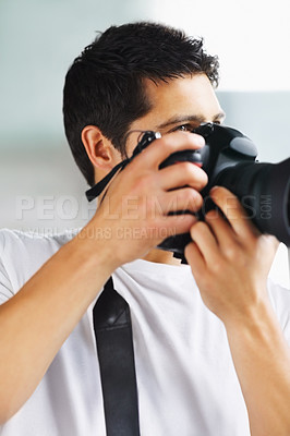 Buy stock photo Male photographer preparing to take a photograph