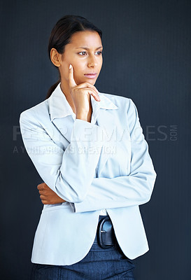 Buy stock photo View of business woman standing with hand on chin