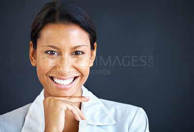 Buy stock photo Closeup of executive smiling while resting chin on hand