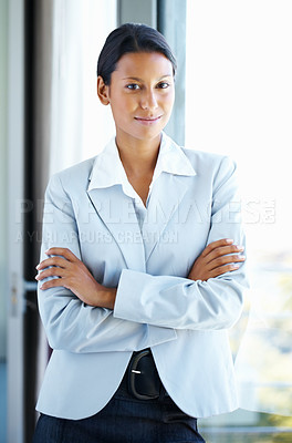 Buy stock photo Business woman standing casually against window