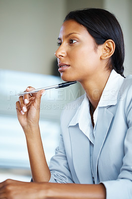 Buy stock photo View of pretty business woman holding pen to chin