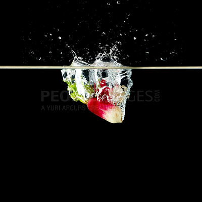 Buy stock photo View of broccoli and radish underwater against black background