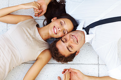 Buy stock photo Portrait of an attractive young couple together resting on floor