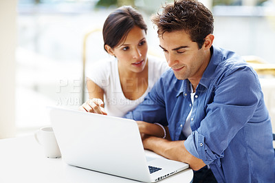 Buy stock photo Portrait of beautiful young couple using laptop - Copyspace