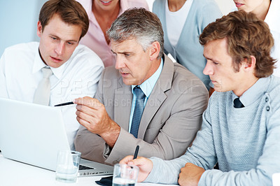 Buy stock photo Senior business man guiding his colleagues in a meeting at office