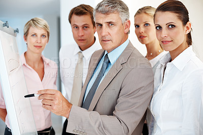 Buy stock photo Business concept - Confident senior man giving presentation to his colleagues at the office