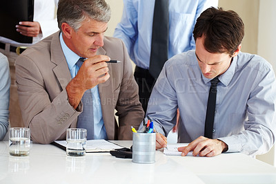 Buy stock photo Senior manager discussing with his business colleague during a meeting at office