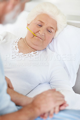 Buy stock photo A senior woman being comforted by her husband while lying in a hospital bed