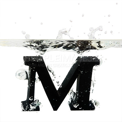 Buy stock photo Letter M dropped into water against white background