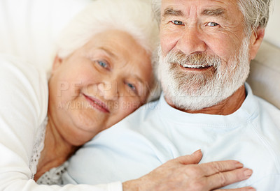 Buy stock photo Portrait of a loving senior couple sitting at home