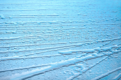 Buy stock photo Low angle view of water drops in row against blue