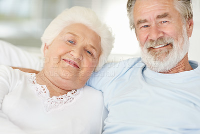 Buy stock photo Portrait of a happy senior couple sitting at home