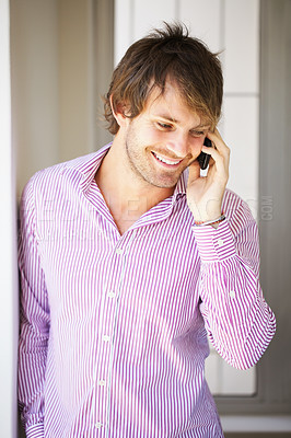 Buy stock photo Smart young business man using cell phone