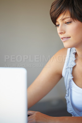 Buy stock photo Young business woman working on laptop