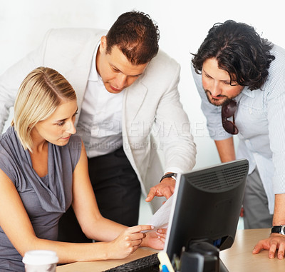 Buy stock photo Mature business man explaining project to his young trainees