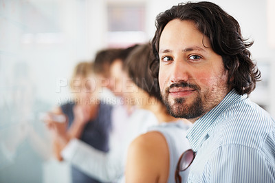 Buy stock photo Portrait of young business man with group of people in background