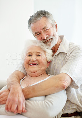 Buy stock photo Portrait of a loving senior man embracing his wife