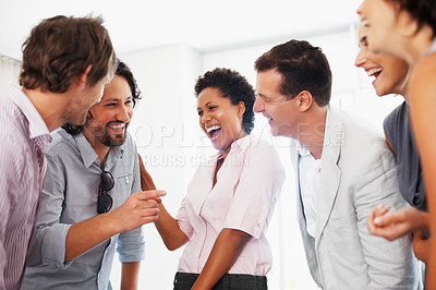 Buy stock photo Successful business people having friendly conversation in office