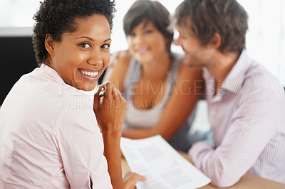 Buy stock photo Portrait of happy African American consultant with couple in background