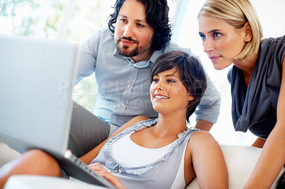 Buy stock photo Pretty business woman with team working on laptop