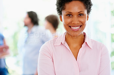 Buy stock photo Closeup of attractive woman with group of people in background