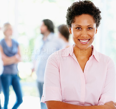 Buy stock photo Attractive woman with arms folded and group of people in background