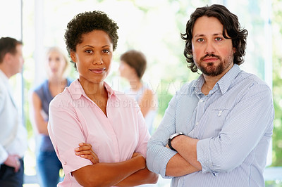 Buy stock photo View of man and woman casually standing with group in background