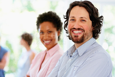 Buy stock photo Focus on leader of group with rest of team in background