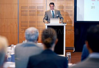 Buy stock photo A confident businessman giving a presentation at a press conference