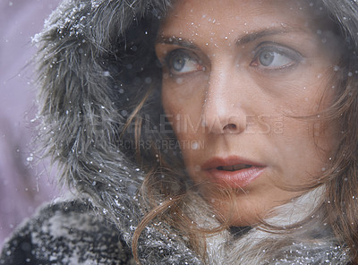 Buy stock photo Shot of an attractive woman standing outside in the snow