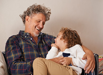 Buy stock photo Shot of a grandfather spending quality time with his grandson indoors