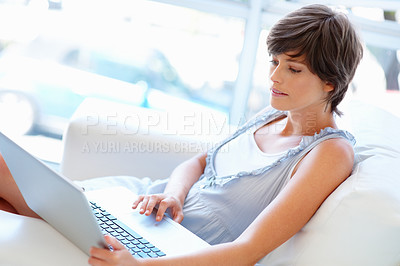 Buy stock photo View of pretty woman looking at laptop