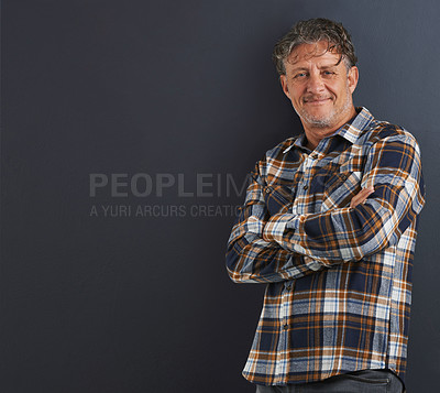 Buy stock photo A portrait of a happy mature man standing against a grey background