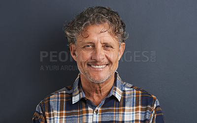 Buy stock photo A cropped portrait of a happy mature man standing against a grey background