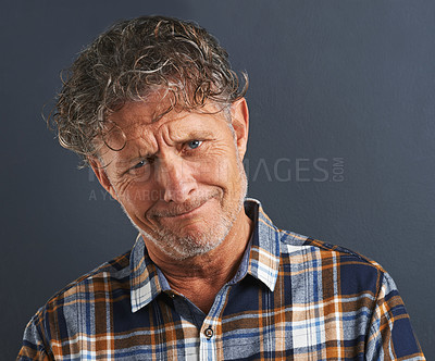 Buy stock photo A cropped portrait of a confused-looking mature man