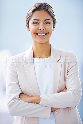 Buy stock photo Portrait of an attractive young businesswoman standing in an office