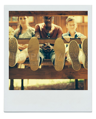 Buy stock photo Framed image of a group of friends chilling outside on a summer day with their shoes in focus in the foreground