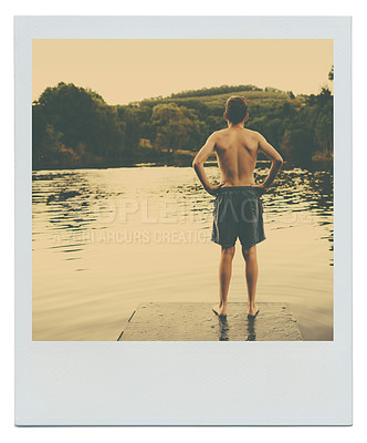 Buy stock photo Shot of a boy standing and looking out at a lake