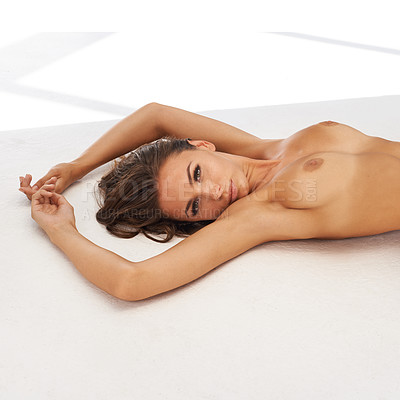 Buy stock photo Cropped shot of a woman lying naked on a white surface