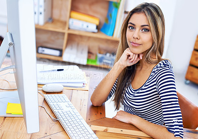 Buy stock photo A portrait of a beautiful young professional sitting at her desk