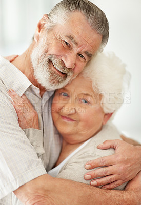 Buy stock photo Portrait of a loving mature couple embracing each other