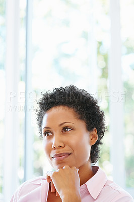 Buy stock photo View of pretty woman sitting with hand on chin