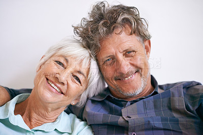 Buy stock photo Portrait of an affectionate senior couple sitting together